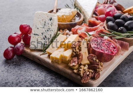 Cheese, meat, grapes and olives antipasto and wine Stock photo © karandaev