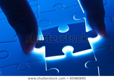 Pick puzzle piece with mystery light Stock photo © Ansonstock