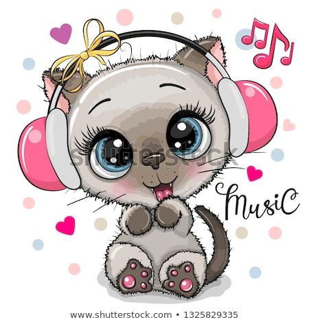 cute kitten with headphones   vector stock photo © adrian_n