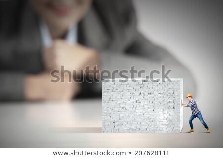 Mujer de negocios empujando invisible pared trabajo fondo Foto stock © photography33