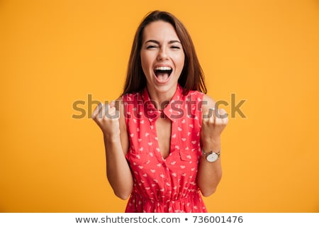 Stock photo: Beautiful woman happy screaming in red dress