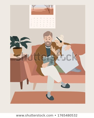 Man reading while his girlfriend listens to music Stock photo © photography33