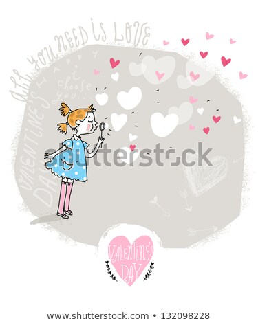 lovely girl with heart-shaped blower Stock photo © dolgachov