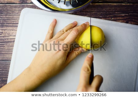 Knife cuts lemon. Stock photo © borysshevchuk
