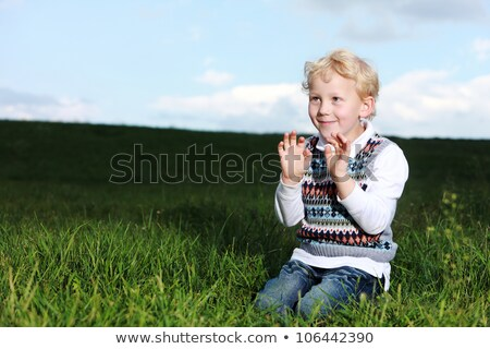 Impish little boy kneeling in green field stock photo © foto-fine-art