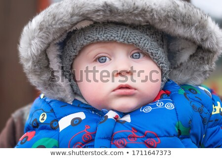 Little boy wearing a fur lined hood Stock photo © foto-fine-art