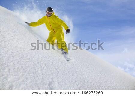 Avontuurlijk man snowboarden beneden heuvel berg Stockfoto © photography33
