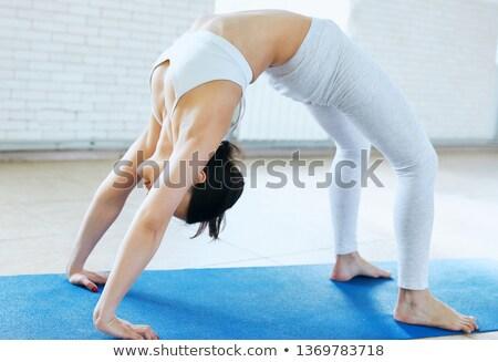 urdhva dhanurasana upward bow pose Stock photo © dolgachov