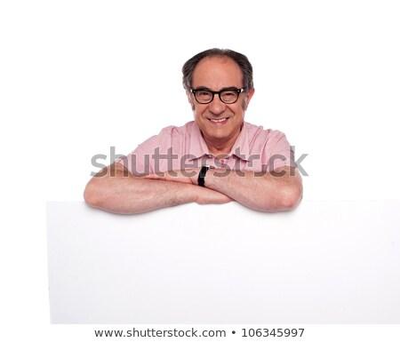 Képviselő áll mögött tábla visel szemüveg Stock fotó © stockyimages