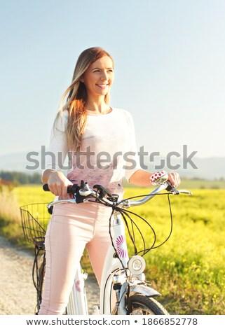 Kadın yeşil ot öğleden sonra yaz gülümseme mutlu Stok fotoğraf © OleksandrO