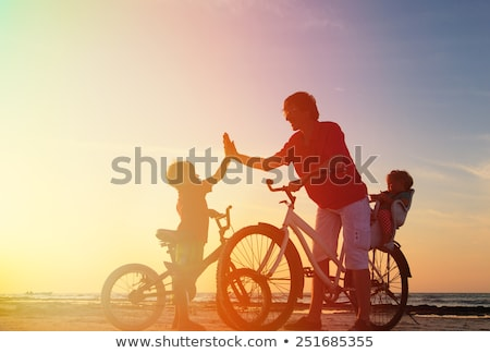 Fathr and little son on bike with child seat Stock photo © pekour