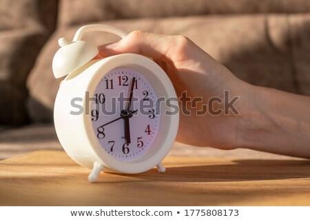 nő · ágy · kéz · ébresztőóra · ingerült · fiatal · nő - stock fotó © photography33