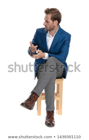 young man sitting on the phone, pointing stock photo © feedough