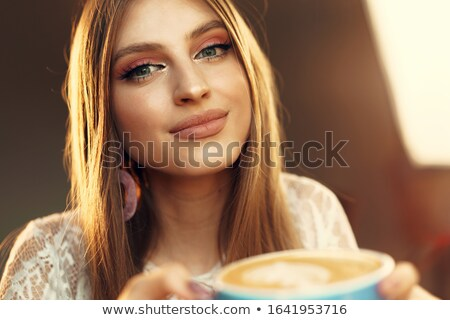 Woman having a hot cup of tea Stock photo © photography33