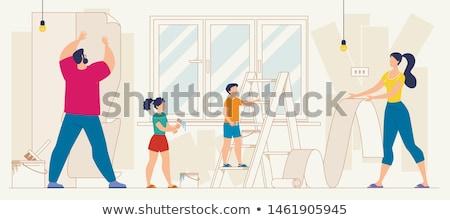 Woman pasting wallpaper stock photo © photography33