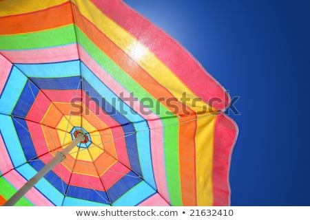 güneşlenme · plaj · renkli · güneş · şemsiyesi · kadın · oturma - stok fotoğraf © ozaiachin