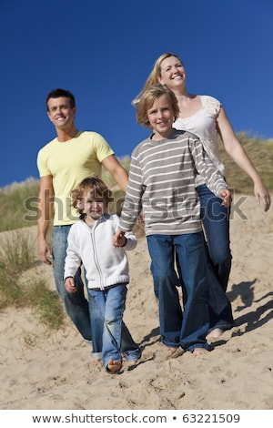 Young family in the sand dunes Stock photo © photography33