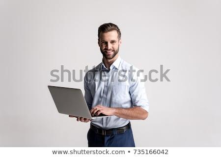 молодые · бизнесмен · Постоянный · ноутбука · белый · бизнеса - Сток-фото © wavebreak_media