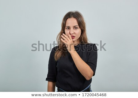 Hush! Beautiful Young Woman showing Silence Sign with her Forefinger. Warning Stock photo © gromovataya