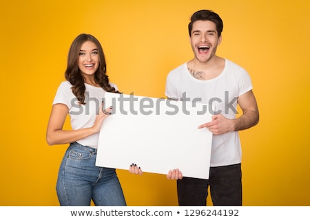 Pár tart üres tábla áll mosolyog fehér Stock fotó © iofoto