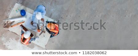 Inşaat planları kask yukarı kâğıt Stok fotoğraf © kuligssen