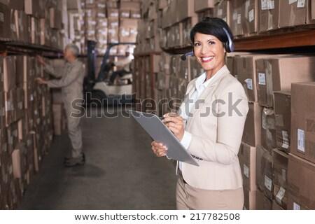 üzletasszony headset tart vágólap portré gyönyörű Stock fotó © williv