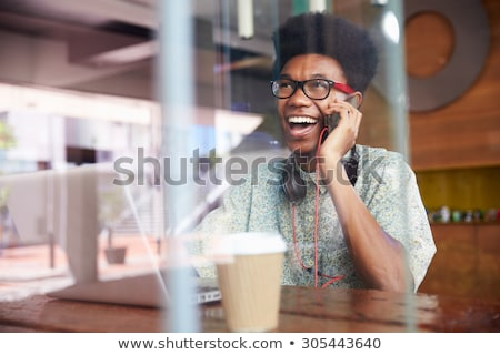 happy businesswoman talking on the cellphone in a cafe stock photo © vlad_star