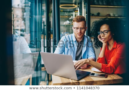 two women during a business meeting with laptop stock photo © ambro