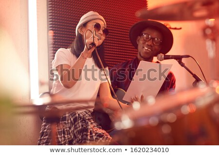 woman with guitar in a recording studio stock photo © sumners