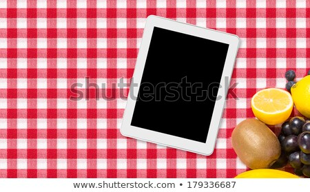 Comprimé fruits nappe textiles ordinateur livre Photo stock © REDPIXEL