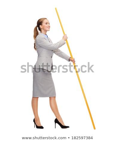 Uśmiechnięta kobieta maszt biały banderą działalności Zdjęcia stock © dolgachov
