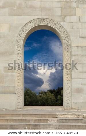 deuropening · blauwe · hemel · opening · zon · streaming · hemel - stockfoto © kimmit