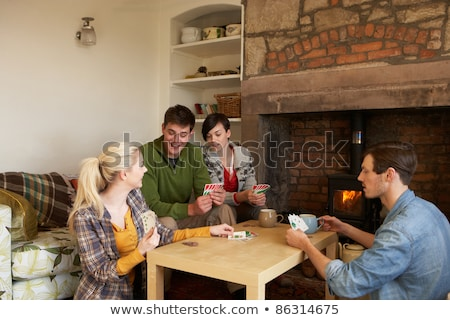 Stockfoto: Young Couples In Cosy Cottage