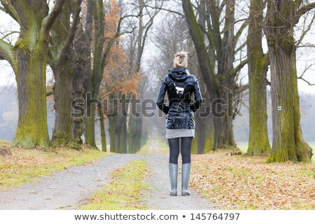 woman wearing rubber boots in alley Stock photo © phbcz