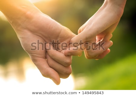 silhouette of a woman and two men holding hands Stock photo © gemenacom