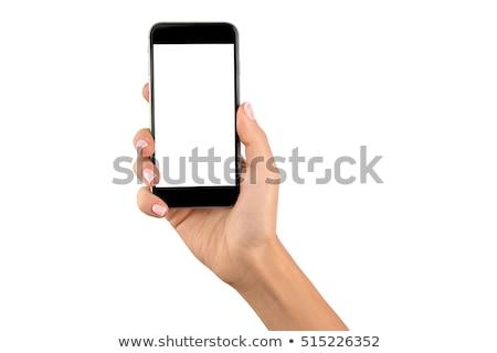 Kéz tart mobiltelefon üzlet számítógép telefon Stock fotó © feelphotoart