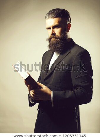 Businessman in a suit holding a book Stock photo © Mikola249