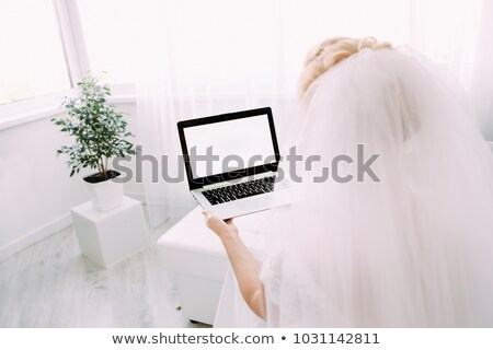 Stock photo: bride working on a computer