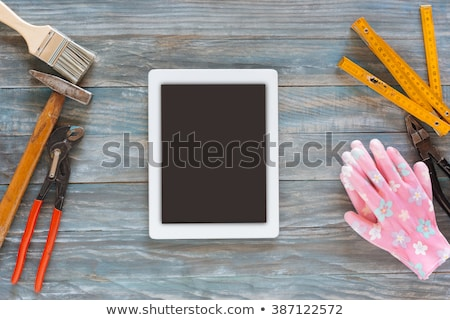 digital tablet and assorted carpentry tools on workshop table stock photo © stevanovicigor