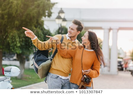 Two elegant men carrying a stunning woman Stock photo © konradbak