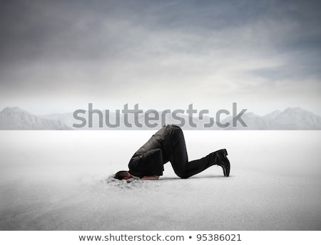 Businessman Hiding His Head In Sand Stock photo © AndreyPopov
