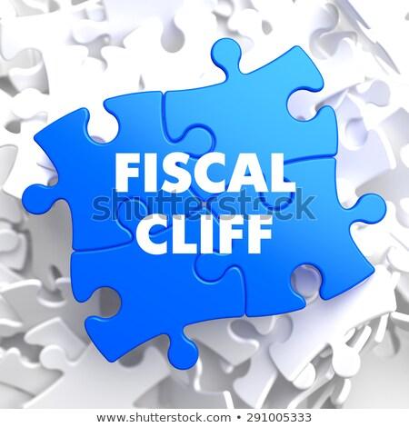 Fiscal Cliff on Blue Puzzle. Stock photo © tashatuvango