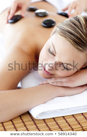 beautiful woman receiving stone massage at spa center stock photo © wavebreak_media