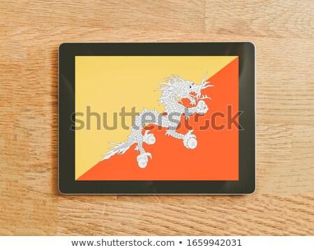 Tablet Bhutan vlag afbeelding gerenderd Stockfoto © tang90246
