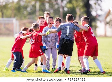 Kinderen voetbal team vieren doel overwinning Stockfoto © stevanovicigor