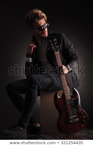 guitarist playing an electric guitar and looks to his side Stock photo © feedough