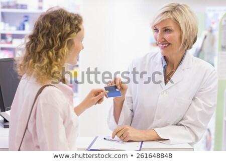 Pharmacist giving credit card to costumer  Stock photo © wavebreak_media
