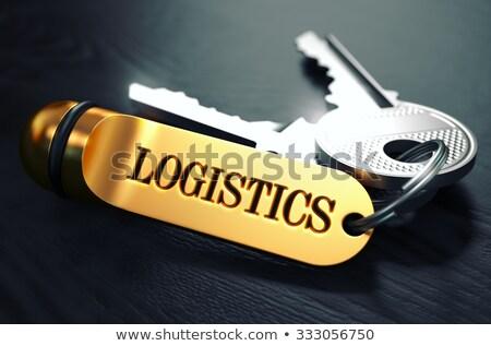 Logistics - Bunch of Keys with Text on Golden Keychain. Stock photo © tashatuvango