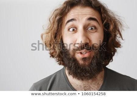 Hombre confuso pelo posando sesión mirando Foto stock © feedough