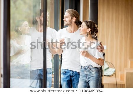 the young couple dressed in white standing at home stock photo © master1305